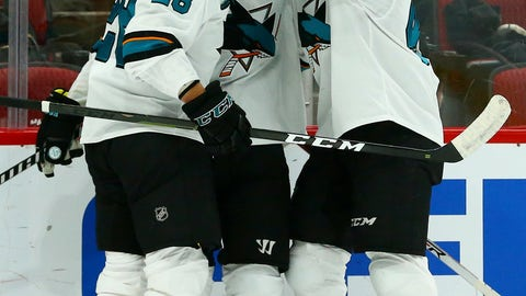 <p>               San Jose Sharks center Logan Couture, middle, celebrates his goal against the Arizona Coyotes with Sharks right wing Timo Meier (28) and center Tomas Hertl (48) during the first period of an NHL hockey game, Saturday, Dec. 8, 2018, in Phoenix. (AP Photo/Ross D. Franklin)             </p>
