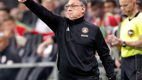 <p>               FILE - In this Nov. 25, 2018, file photo, Atlanta United head coach Gerardo Tata Martino directs his players in a MLS soccer playoff game against the New York Red Bulls, in Atlanta. Martino will be celebrated for bringing instant MLS success to Atlanta. If he can add the MLS Cup championship to Atlanta United in his final game as coach, his status as a legend will be difficult for his successor to match. (AP Photo/John Bazemore, File)             </p>