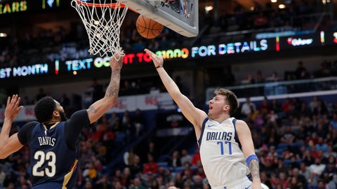 <p>               Dallas Mavericks forward Luka Doncic (77) goes to the basket against New Orleans Pelicans forward Anthony Davis (23) during the first half of an NBA basketball game in New Orleans, Friday, Dec. 28, 2018. (AP Photo/Gerald Herbert)             </p>