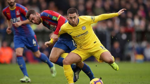 <p>               Chelsea's Eden Hazard and Crystal Palace's James McArthur, left, during their English Premier League soccer match at Selhurst Park in London, Sunday Dec. 30, 2018. (John Walton/PA via AP)             </p>