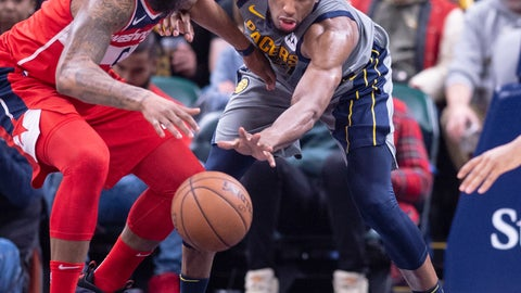 <p>               Washington Wizards forward Markieff Morris (5), left, and Indiana Pacers forward Thaddeus Young (21) battle for the ball during the second half of an NBA basketball game, Sunday, Dec. 23, 2018, in Indianapolis. (AP Photo/Doug McSchooler)             </p>
