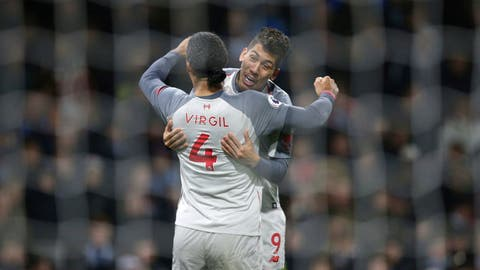 <p>               Liverpool's Roberto Firmino celebrates scoring his side's second goal of the game with team-mate Virgil van Dijk, during their English Premier League soccer match at Turf Moor in Burnley, England, Wednesday Dec. 5, 2018. (Nigel French/PA via AP)             </p>
