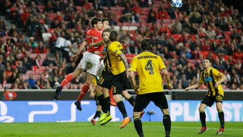 <p>               Benfica's Ruben Dias, left, heads the ball challenged by AEK's Dmytro Chygrynskiy, 4th from right, during the Champions League group E soccer match between Benfica and AEK Athens at the Luz stadium in Lisbon, Wednesday, Dec. 12, 2018. (AP Photo/Armando Franca)             </p>