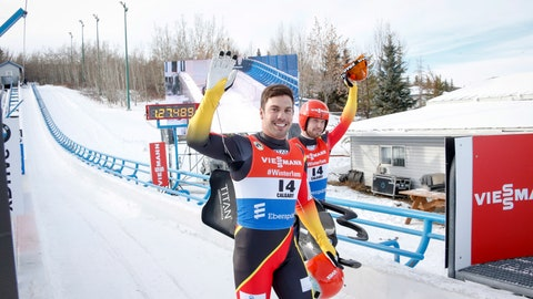 <p>               Germany's Tobias Wendl, left, and Tobias Arlt, celebrate their victory in the men's doubles World Cup luge competition in Calgary, Alberta, Friday, Dec. 7, 2018. (Jeff McIntosh/The Canadian Press via AP)             </p>