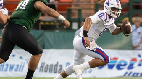 <p>               Hawaii defensive lineman Manly Williams (49) attempts to chase down Louisiana Tech quarterback J'Mar Smith (8) in the first half of the Hawaii Bowl NCAA college football game, Saturday, Dec. 22, 2018, in Honolulu. (AP Photo/Eugene Tanner)             </p>