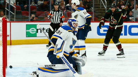<p>               St. Louis Blues goaltender Chad Johnson (31) gives up a goal to Arizona Coyotes' Clayton Keller as Blues center Robert Thomas (18) looks away and Coyotes center Alex Galchenyuk, right, celebrates during the second period of an NHL hockey game, Saturday, Dec. 1, 2018, in Glendale, Ariz. (AP Photo/Ross D. Franklin)             </p>