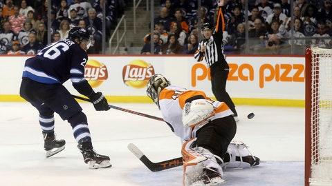 <p>               Winnipeg Jets' Blake Wheeler (26) scores a short-handed goal against Philadelphia Flyers' goaltender Anthony Stolarz (41) during second-period NHL hockey  game action in Winnipeg, Manitoba, Sunday, Dec. 9, 2018. (Trevor Hagan/The Canadian Press via AP)             </p>
