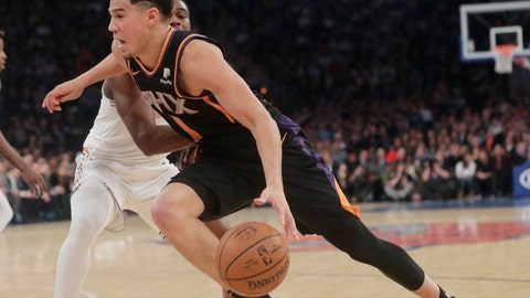 <p>               Phoenix Suns' Austin Rivers (1) drives past New York Knicks' Emmanuel Mudiay (1) during the first half of an NBA basketball game Monday, Dec. 17, 2018, in New York. (AP Photo/Frank Franklin II)             </p>