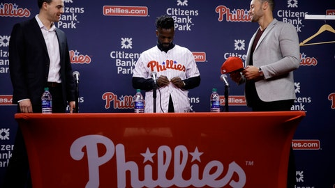 <p>               Philadelphia Phillies new outfielder Andrew McCutchen, center, accompanied by general manager Matt Klentak, left, and manager Gabe Kapler, puts on his uniform during a news conference in Philadelphia, Tuesday, Dec. 18, 2018. McCutchen and the Philadelphia Phillies finalized a back-loaded $50 million, three-year contract last week, a deal that includes a team option for 2022. (AP Photo/Matt Rourke)             </p>