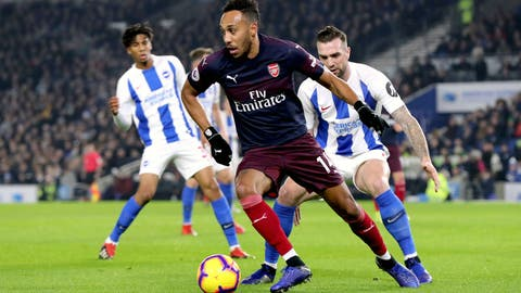 <p>               Arsenal's Pierre-Emerick Aubameyang in action during the English Premier League soccer match against Brighton at the AMEX Stadium, Brighton, Wednesday Dec. 26, 2018. (Gareth Fuller/PA via AP)             </p>