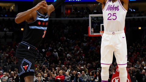 <p>               Minnesota Timberwolves guard Derrick Rose (25) shoots over Chicago Bulls guard Kris Dunn during the first half of an NBA basketball game Wednesday, Dec. 26, 2018, in Chicago. (AP Photo/Matt Marton)             </p>