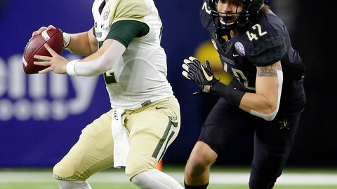 <p>               Baylor quarterback Charlie Brewer (12) looks to pass the ball as Vanderbilt linebacker Kenny Hebert (42) closes in during the first half of the Texas Bowl NCAA college football game Thursday, Dec. 27, 2018, in Houston. (AP Photo/Michael Wyke)             </p>