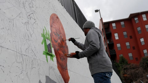 "<p>               In this Dec. 13, 2018, photo, Muhammad Yungai paints mural on a building near the Mercedes Benz Stadium in Atlanta. A series of about 30 murals on walls around the downtown Atlanta stadium that will host the Super Bowl aims to highlight Atlanta's civil rights legacy. The murals are part of an initiative called ""Off The Wall: Atlanta's Civil Rights and Social Justice Journey."" (AP Photo/John Bazemore)             </p>"