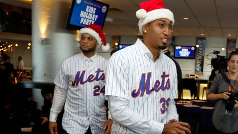 <p>               Robinson Cano, left, and Edwin Diaz wear Santa hats as they arrive to participate in the New York Mets annual Kids Holiday Party, at CitiField, in New York, Tuesday, Dec. 4, 2018. The Mets acquired eight-time All-Star second baseman Robinson Cano and major league saves leader Edwin Diaz from the Seattle Mariners in a seven-player trade Monday. (AP Photo/Richard Drew)             </p>