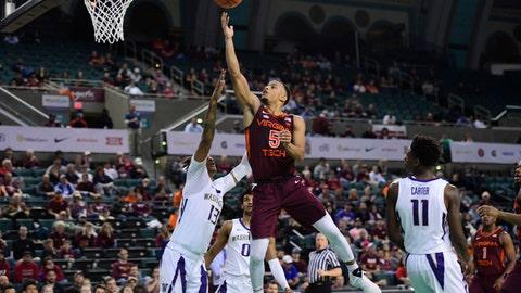 <p>               Virginia Tech guard Justin Robinson (5) scores against Washington forward Hameir Wright (13) during the first half of an NCAA college basketball game, Saturday, Dec. 15, 2018 in Atlantic City, N.J. (AP Photo/Corey Perrine)             </p>