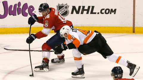 <p>               Florida Panthers center Aleksander Barkov (16) shoots under pressure from Philadelphia Flyers defenseman Andrew MacDonald (47) in the second period of an NHL hockey game, Saturday Dec. 29, 2018, in Sunrise, Fla. (AP Photo/Joe Skipper)             </p>