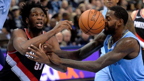 <p>               Portland Trail Blazers forward Caleb Swanigan (50) and Memphis Grizzlies forward JaMychal Green, right, struggle for control of the ball in the second half of an NBA basketball game on Wednesday, Dec. 12, 2018, in Memphis, Tenn. (AP Photo/Brandon Dill)             </p>