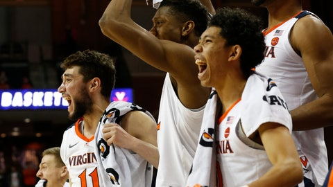 <p>               Virginia guard Ty Jerome (11) and the rest of the bench celebrate a basket during the second half of an NCAA college basketball game in Charlottesville, Va., Monday, Dec. 3, 2018. Virginia defeated Morgan State 83-45. (AP Photo/Steve Helber)             </p>