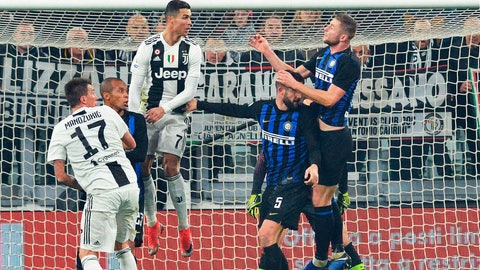 <p>               Juventus' Cristiano Ronaldo, 3rd from left, heads the ball during the Serie A soccer match between Juventus and Inter Milan at the Turin Allianz stadium, Italy, Friday, Dec. 7, 2018. (Andrea Di Marco/ANSA via AP)             </p>