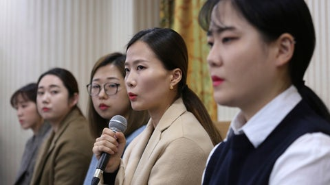 """<p>               FILE - In this Nov. 15, 2018 file photo, Kim Eun-jung, second from right, a member of South Korean Olympic women's curling team, speaks during a press conference in Seoul, South Korea. A beleaguered South Korean curling official on Tuesday, Dec. 4, 2018, said he and his family will leave the sport for good as the government investigates their alleged abusive treatment of the """"Garlic Girls,"""" the country's hugely popular Olympic silver medalists. (AP Photo/Ahn Young-joon, File)             </p>"""