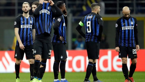 <p>               Inter Milan's players react at the end of the Champions League, Group B soccer match between Inter Milan and PSV Eindhoven, at the San Siro stadium in Milan, Italy, Tuesday, Dec. 11, 2018. (AP Photo/Luca Bruno)             </p>
