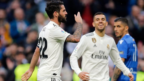 <p>               Real Madrid's Isco, left celebrates after scoring his side's fourth goal during a round of 32, 2nd leg, Spanish Copa del Rey soccer match between Real Madrid and Melilla at the Santiago Bernabeu stadium in Madrid, Spain, Thursday, Dec. 6, 2018. (AP Photo/Paul White)             </p>