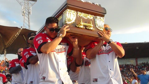 <p>               Players from the Cardenales de Lara baseball team carry the caskets of teammates and former major league players Luis Valbuena and Jose Castillo at a baseball stadium in Barquisimeto, Venezuela, Friday, Dec. 7, 2018. The two were killed in a car crash caused by highway bandits who then robbed them, officials said Friday. Valbuena and Castillo died late Thursday when their SUV crashed as it tried to veer around an object placed in the road, Yaracuy state Gov. Julio Leon Heredia said on his Twitter account. (AP Photo/Nestor Vivas)             </p>