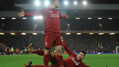 <p>               Liverpool's Xherdan Shaqiri celebrates after scoring his side's second goal during the English Premier League soccer match between Liverpool and Manchester United at Anfield in Liverpool, England, Sunday, Dec. 16, 2018. (AP Photo/Rui Vieira)             </p>