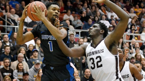 <p>               Buffalo forward Montell McRae, left, grabs a rebound against St. Bonaventure center Amadi Ikpeze during the first half of an NCAA college basketball game in Olean, N.Y., Saturday, Dec. 8, 2018. (AP Photo/Adrian Kraus)             </p>