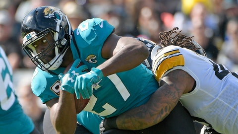 <p>               FILE - In this Nov. 18, 2018, file photo, Jacksonville Jaguars running back Leonard Fournette, left, runs for yardage as he is stopped by Pittsburgh Steelers outside linebacker Bud Dupree, right, during the first half of an NFL football game in Jacksonville, Fla. Jaguars coach Doug Marrone says Fournette was responding to racial slurs while yelling at a fan in Nashville, Tenn., last Thursday, Dec. 6, 2018. Fournette declined to address the accusation in the locker room Monday, Dec. 10, 2018, on the advice of his agent. (AP Photo/Phelan M. Ebenhack, File)             </p>