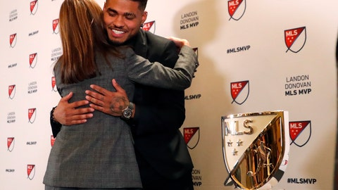 <p>               Atlanta United soccer player Josef Martinez is embraced by Angie Blank wife of team owner Arthur Blank after it was announced he had won the Landon Donovan MLS MVP award Wednesday, Dec. 5, 2018, in Atlanta. (AP Photo/John Bazemore)             </p>