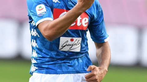 <p>               Napoli's Adam Ounas celebrates after scoring his side's second goal during the Serie A soccer match between Napoli and Frosinone, at the San Paolo stadium in Naples, Italy, Saturday, Dec. 8, 2018. (Ciro Fusco /ANSA via AP)             </p>