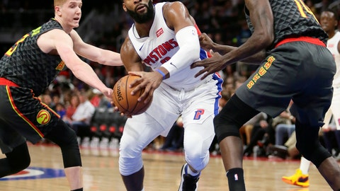 <p>               Detroit Pistons center Andre Drummond, center, drives to the basket against Atlanta Hawks guard Kevin Huerter, left, and Atlanta Hawks center Dewayne Dedmon during the first half on an NBA basketball game Sunday, Dec. 23, 2018, in Detroit. (AP Photo/Duane Burleson)             </p>