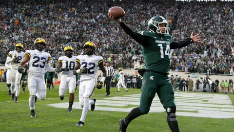 <p>               FILE - In this Oct. 20, 2018, file photo, Michigan State quarterback Brian Lewerke, right, celebrates after making a touchdown reception during the third quarter against Michigan in an NCAA college football game in East Lansing, Mich. Michigan State plays Oregon in the Redbox Bowl on Monday. The time off before the bowl did a lot for Lewerke, who missed three games down the stretch with a shoulder injury. Coach Mark Dantonio said Lewerke's arm strength is back and he will start the bowl game. (AP Photo/Al Goldis, File)             </p>