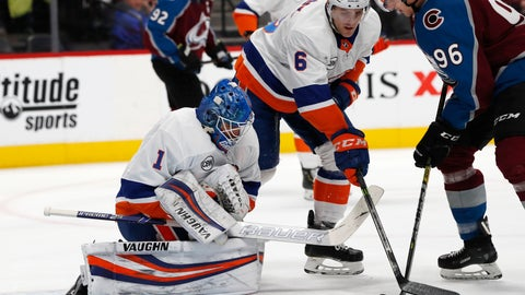 <p>               New York Islanders goaltender Thomas Greiss, left, stops a shot off the stick of Colorado Avalanche right wing Mikko Rantanen, right, as New York defenseman Ryan Pulock covers in the first period of an NHL hockey game Monday, Dec. 17, 2018, in Denver. (AP Photo/David Zalubowski)             </p>