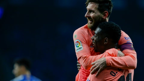 <p>               FC Barcelona's Lionel Messi celebrates with teammate Ousmane Dembele during the Spanish La Liga soccer match between Espanyol and FC Barcelona at RCDE stadium in Cornella Llobregat, Spain, Saturday, Dec. 8, 2018. (AP Photo/Joan Monfort)             </p>
