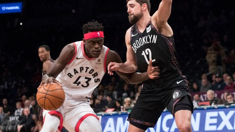 <p>               Toronto Raptors forward Pascal Siakam (43) drives to the basket against Brooklyn Nets forward Joe Harris (12) during the first half of an NBA basketball game, Friday, Dec. 7, 2018, in New York. (AP Photo/Mary Altaffer)             </p>