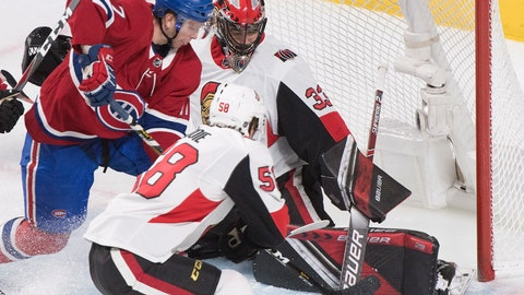 <p>               Montreal Canadiens defenseman Brett Kulak (17) battles for control of the puck with Ottawa Senators goaltender Mike McKenna and defenseman Maxime Lajoie (58) during second-period NHL hockey game action in Montreal, Saturday, Dec. 15, 2018. (Graham Hughes/The Canadian Press via AP)             </p>