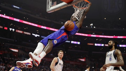<p>               Los Angeles Clippers' Montrezl Harrell dunks in front of Dallas Mavericks' DeAndre Jordan. right, and Luka Doncic during the first half of an NBA basketball game Thursday, Dec. 20, 2018, in Los Angeles. (AP Photo/Marcio Jose Sanchez)             </p>