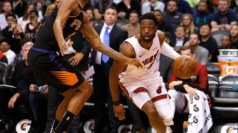 <p>               Miami Heat guard Dwyane Wade (3) drives around Phoenix Suns forward Trevor Ariza during the first half of an NBA basketball game Friday, Dec. 7, 2018, in Phoenix. (AP Photo/Rick Scuteri)             </p>