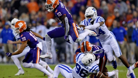<p>               FILE - In this Nov. 17, 2018, file photo, Clemson's Derion Kendrick (10) hurdles Duke's Chris Rumph ll (96) on a kickoff return as Jarrett Garner reaches for him during the first half of an NCAA college football game in Clemson, S.C. Kickoff returns are down about 20 percent in the first year of a new NCAA rule that gives the receiving team possession at its 25-yard line if the kick is fair caught anywhere between the goal line and 25. (AP Photo/Richard Shiro, File)             </p>