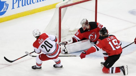 <p>               New Jersey Devils goaltender MacKenzie Blackwood, center, blocks a shot from Carolina Hurricanes center Sebastian Aho (20), of Finland, as Travis Zajac (19) helps defend during the third period of an NHL hockey game, Saturday, Dec. 29, 2018, in Newark, N.J. The Devils won 2-0. (AP Photo/Julio Cortez)             </p>