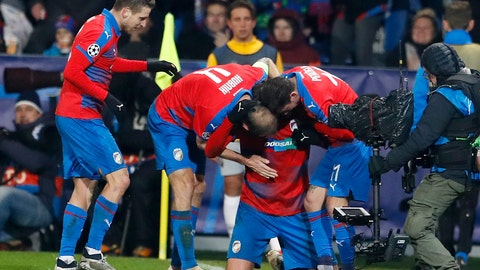 <p>               Plzen's Tomas Chory, second from right, celebrates with his teammates after scoring his side's second goal during the Champions League group G soccer match between Viktoria Plzen and Roma at the Doosan arena in Pilsen, Czech Republic, Wednesday, Dec. 12, 2018. (AP Photo/Petr David Josek)             </p>