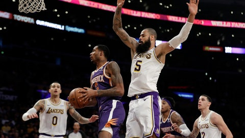 <p>               Phoenix Suns' Trevor Ariza, second from left, drives past Los Angeles Lakers' Tyson Chandler (5) during the first half of an NBA basketball game Sunday, Dec. 2, 2018, in Los Angeles. (AP Photo/Marcio Jose Sanchez)             </p>