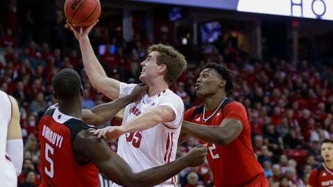 <p>               Wisconsin's Nate Reuvers (35) goes for a defensive rebound against Rutgers' Eugene Omoruyi (5) and Shaquille Doorson during the first half of an NCAA college basketball game Monday, Dec. 3, 2018, in Madison, Wis. (AP Photo/Andy Manis)             </p>