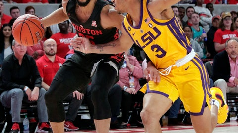 <p>               Houston guard Galen Robinson Jr. (25) drives down court as LSU guard Tremont Waters (3) defends during the first half of an NCAA college basketball game Wednesday, Dec. 12, 2018, in Houston. (AP Photo/Michael Wyke)             </p>