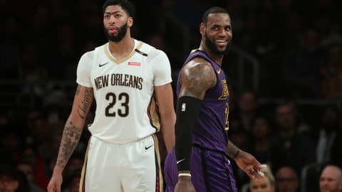 <p>               Los Angeles Lakers' LeBron James, right, smiles as he walks past New Orleans Pelicans' Anthony Davis during the first half of an NBA basketball game Friday, Dec. 21, 2018, in Los Angeles. (AP Photo/Jae C. Hong)             </p>