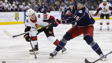 <p>               Columbus Blue Jackets' Pierre-Luc Dubois, right, shoots the puck as Ottawa Senators' Maxime Lajoie defends during the second period of an NHL hockey game Monday, Dec. 31, 2018, in Columbus, Ohio. (AP Photo/Jay LaPrete)             </p>