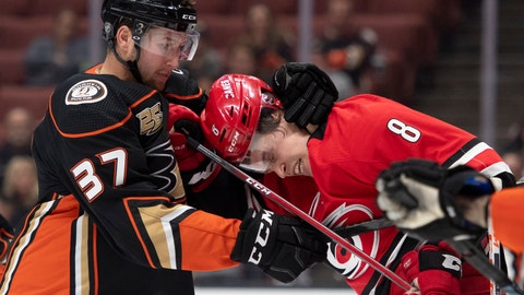 <p>               Anaheim Ducks left wing Nick Ritchie, left, pulls Carolina Hurricanes right wing Saku Maenalanen away from Anaheim Ducks goaltender John Gibson during the first period of an NHL hockey game in Anaheim, Calif., Friday, Dec. 7, 2018. (AP Photo/Kyusung Gong)             </p>