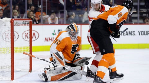 <p>               Philadelphia Flyers' Carter Hart, left, blocks a shot as Detroit Red Wings' Justin Abdelkader, center, and Travis Sanheim look for the rebound during the first period of an NHL hockey game, Tuesday, Dec. 18, 2018, in Philadelphia. (AP Photo/Matt Slocum)             </p>